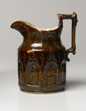 "American Pottery Company (1833-1845). Pitcher, ""Apostle's Pitcher,"" after 1842. Glazed Earthenware, 9 1/4 in. H (23.5 cm). Brooklyn Museum, Gift of Arthur W. Clement, 43.128.27. Creative Commons-BY"