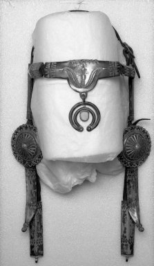 Navajo (Native American). Bridle with Conches, late 19th or early 20th century. Hide, iron, silver, turquoise, 21 x 12 1/2 x 7 in. (53.3 x 31.8 x 17.8 cm). Brooklyn Museum, Anonymous gift in memory of Dr. Harlow Brooks, 43.201.139. Creative Commons-BY