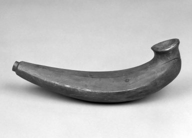 Eskimo (Native American). Pipe, 20th century. Wood, metal, 13 x 3 x 4 1/2 in. or (31.0 x 7.0 cm). Brooklyn Museum, Anonymous gift in memory of Dr. Harlow Brooks, 43.201.153. Creative Commons-BY