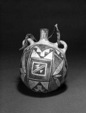 Haak'u (Acoma Pueblo) (Native American). Canteen. Clay, slip, cloth, 7 1/2 x 5 1/2 in (19 x 14 cm). Brooklyn Museum, Anonymous gift in memory of Dr. Harlow Brooks, 43.201.209. Creative Commons-BY
