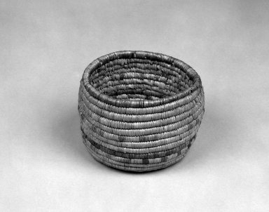 Eskimo (Native American). Coiled Cylindrical Basket, 20th century. plant material, 5 1/2 x 5 1/2 x 3 7/8 in. or (9.5 x 12.5 cm). Brooklyn Museum, Anonymous gift in memory of Dr. Harlow Brooks, 43.201.297. Creative Commons-BY