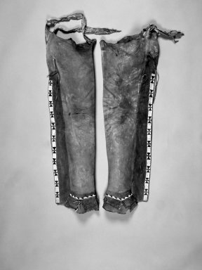 Apache (Native American). Painted Leggings. Hide, beads Brooklyn Museum, Anonymous gift in memory of Dr. Harlow Brooks, 43.201.3a-b. Creative Commons-BY