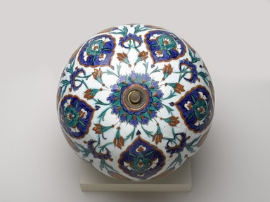 Spherical Hanging Ornament, 1575-1585. Ceramic; fritware, painted in black, cobalt blue, green, and red on a white slip ground under a transparent glaze, 4 5/16 x 4 5/16 x 11 15/16in. (11 x 11 x 30.3cm). Brooklyn Museum, Gift of Mr. and Mrs. Frederic B. Pratt, 43.24.8. Creative Commons-BY