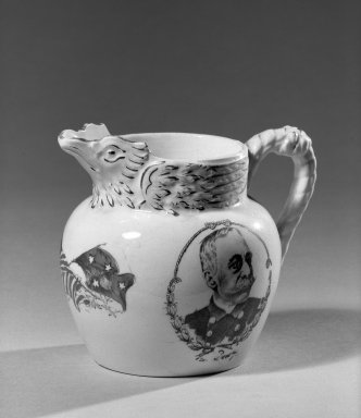 Cook Pottery Company. Pitcher, 1899. White earthenware, 4 x 4 5/8 x 2 5/8 in. (10.2 x 11.7 x 6.7 cm). Brooklyn Museum, Gift of Arthur W. Clement, 44.1.34. Creative Commons-BY