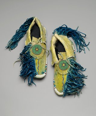 Kiowa (Native American). Pair of Moccasins, mid-20th century. Hide, beads, pigments, 10 1/4 x 3 13/16 in.  (26 x 9.7 cm). Brooklyn Museum, Gift of the Estate of Ida Jacobus Grant, 44.116.11a-b. Creative Commons-BY