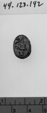 Scarab of Amenhotep I. Steatite, glazed, 7/16 x 11/16 in. (1.1 x 1.8 cm). Brooklyn Museum, Charles Edwin Wilbour Fund, 44.123.142. Creative Commons-BY