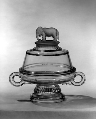"""Canton Glass Company (American, (1883-after 1999)). Butter Dish with Lid, """"Jumbo"""" pattern, ca. 1882. Glass, 7 1/4 x 7 7/8 x 5 5/8 in. (18.4 x 20 x 14.3 cm). Brooklyn Museum, Gift of Mrs. Edwin P. Maynard, 44.32.8a-b. Creative Commons-BY"""