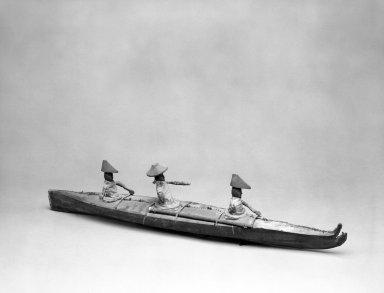 Aleut (Native American). Model of Bidarka Boat with three seated figures. Seal intestines?, wood, bone, fur, pigment, 26 1/4 x 6 x 4 in. or (6.8 x 10.0 x 15.0 cm). Brooklyn Museum, A. Augustus Healy Fund, 44.34.5. Creative Commons-BY