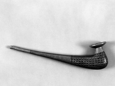 Inupiaq Eskimo (Native American). Tobacco Pipe with lead inlay. Wood, lead, 10 3/4 x 3 1/4 x 1 1/2 in. or (27.5 x 7.5 cm). Brooklyn Museum, A. Augustus Healy Fund, 44.34.6. Creative Commons-BY