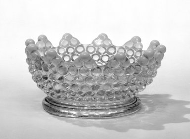 American. Dish, late 19th century. Pressed glass, 2 1/8 x 4 3/4 in. (5.4 x 12.1 cm). Brooklyn Museum, Gift of Arthur W. Clement, 45.1.20. Creative Commons-BY