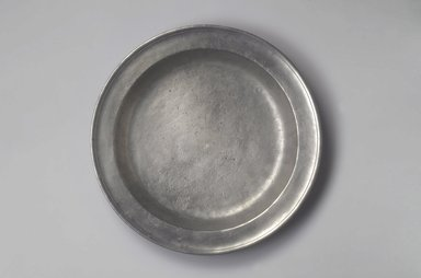 Jacob Eggleston. Plate, 1795-1813. Pewter, 1 1/2 x 13 1/4 x 13 1/4 in. (3.8 x 33.7 x 33.7 cm). Brooklyn Museum, Gift of Arthur W. Clement, 45.1.31. Creative Commons-BY