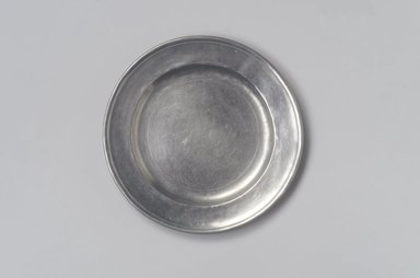Jehiel Johnson. Plate, 1815-1825. Pewter, 5/8 x 7 15/16 x 7 15/16 in. (1.6 x 20.2 x 20.2 cm). Brooklyn Museum, Gift of Arthur W. Clement, 45.1.5. Creative Commons-BY