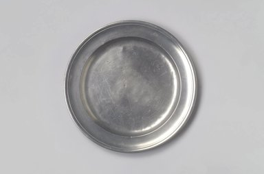 Frederick Bassett (American, active 1761-1800). Plate, 1761-1800. Pewter, 5/8 x 8 1/2 x 8 1/2 in. (1.6 x 21.6 x 21.6 cm). Brooklyn Museum, Designated Purchase Fund, 45.10.162. Creative Commons-BY