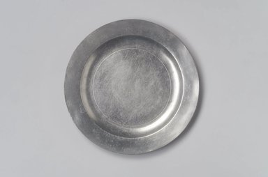 Possibly Thomas Byles (1738-1771). Plate, 18th century. Pewter, 5/8 x 8 1/2 x 8 1/2 in. (1.6 x 21.6 x 21.6 cm). Brooklyn Museum, Designated Purchase Fund, 45.10.241. Creative Commons-BY