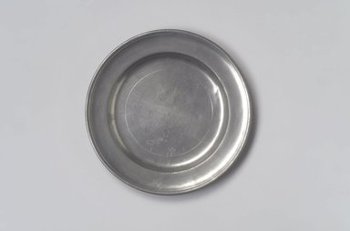 Samuel Pierce. Plate, 1792-1830. Pewter, 5/8 x 7 15/16 x 7 15/16 in. (1.6 x 20.2 x 20.2 cm). Brooklyn Museum, Designated Purchase Fund, 45.10.25. Creative Commons-BY