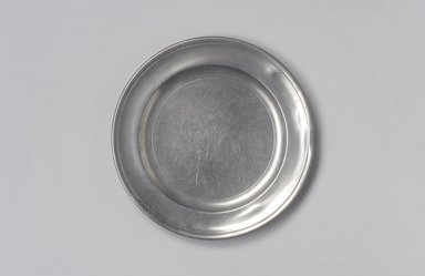Jacob Whitmore. Plate, 1758-1790. Pewter, 5/8 x 7 7/8 x 7 7/8 in. (1.6 x 20 x 20 cm). Brooklyn Museum, Designated Purchase Fund, 45.10.74. Creative Commons-BY