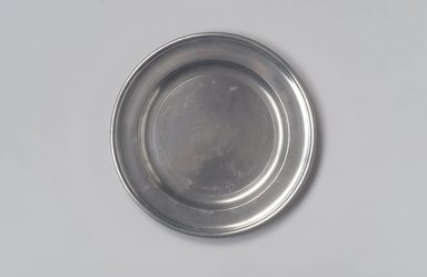 Joseph Danforth. Plate (Used as Paten), 1780-1788. Pewter, 5/8 x 8 x 8 in. (1.6 x 20.3 x 20.3 cm). Brooklyn Museum, Designated Purchase Fund, 45.10.81. Creative Commons-BY