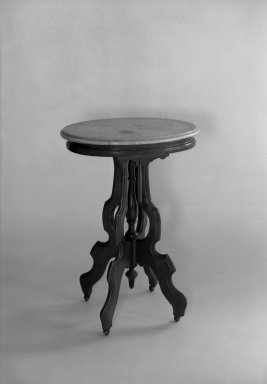 T. Brooks & Company. Oval Table. Marble top on walnut frame Brooklyn Museum, Gift of Eleanor Curnow in memory of her mother, Mary Griffith Curnow, 45.25.4. Creative Commons-BY