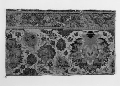 Border Fragment of a Carpet with Pattern of Scrolling Vines and Animals, early 17th century. Wool and cotton, 31 x 18 1/2 in. (78.7 x 47 cm). Brooklyn Museum, Brooklyn Museum Collection, X1103.3. Creative Commons-BY