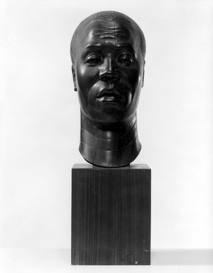Harry Levine (American, born Russia, 1893-1945). Negro Head, n.d. Lignum vitae (wood), With Base: 18 x 5 5/8 x 7 3/4 in. (45.7 x 14.3 x 19.7 cm). Brooklyn Museum, Gift of the Educational Alliance Art School, 45.67.1. © Estate of Harry Levine