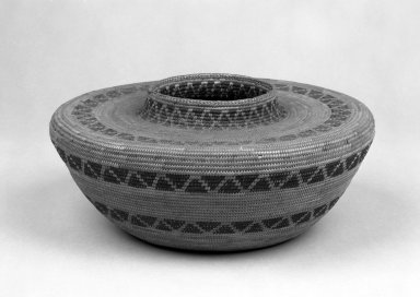 Yokuts (Native American). Coiled Basket with Flat Shoulders and Short Straight Neck decorated with bands of triangles. Fiber, 5 5/16 in.  (13.5 cm). Brooklyn Museum, Gift of Pratt Institute, 46.136.4. Creative Commons-BY