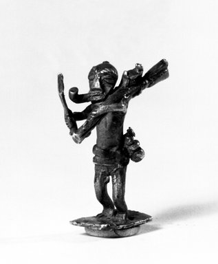 Akan. Weight. Brass, 1 1/2 x 11/16 x 1/2 in. (3.8 x 1.8 x 1.2 cm). Brooklyn Museum, Charles Stewart Smith Memorial Fund, 46.95.1. Creative Commons-BY