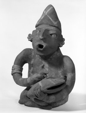 Figurine of a Man. Pottery, 9 1/2 x 6 1/2 x 5 1/2 in. (24.1 x 16.5 x 14 cm). Brooklyn Museum, Frank L. Babbott Fund, 47.186.1. Creative Commons-BY