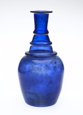 Bottle, 19th century. Translucent deep blue glass; free blown; tooled on the pontil, 7 7/8 x 3 15/16 in. (20 x 10 cm). Brooklyn Museum, Henry L. Batterman Fund, 47.203.10. Creative Commons-BY
