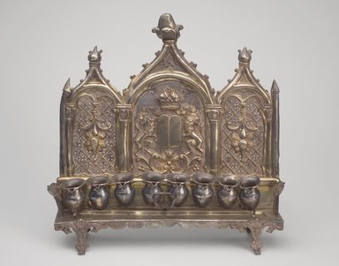 Hanukkah Menorah, late 19th century. Silver, 10 1/2 x 10 5/8 x 2 7/8 in. (26.7 x 27 x 7.3 cm). Brooklyn Museum, Purchased with funds given by Mr. and Mrs. Benjamin Abrams, 49.228.11. Creative Commons-BY