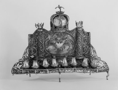 Hanukkah Menorah, ca. 1830-1850. Silver, 9 1/2 x 12 1/8 x 3 1/2 in. (24.1 x 30.8 x 8.9 cm). Brooklyn Museum, Purchased with funds given by Fred Zeitz, 49.228.14. Creative Commons-BY
