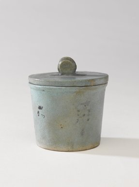 One of a Set of Jars for Seven Sacred Oils or Unguents, 305-30 B.C.E. Faience, 2 1/2 x 2 3/8 in. (6.4 x 6 cm). Brooklyn Museum, Charles Edwin Wilbour Fund, 49.52.1a-b. Creative Commons-BY