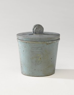 One of a Set of Jars for Seven Sacred Oils or Unguents, 305-30 B.C.E. Faience, 2 1/2 x 2 3/8 in. (6.4 x 6 cm). Brooklyn Museum, Charles Edwin Wilbour Fund, 49.52.2a-b. Creative Commons-BY