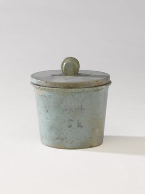 One of a Set of Jars for Seven Sacred Oils or Unguents, 305-30 B.C.E. Faience, 2 1/2 x 2 3/8 in. (6.4 x 6 cm). Brooklyn Museum, Charles Edwin Wilbour Fund, 49.52.6a-b. Creative Commons-BY