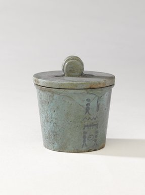 One of a Set of Jars for Seven Sacred Oils or Unguents, 305-30 B.C.E. Faience, 2 1/2 x 2 3/8 in. (6.4 x 6 cm). Brooklyn Museum, Charles Edwin Wilbour Fund, 49.52.7a-b. Creative Commons-BY