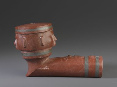 Sisseton, Sioux (Native American). Inlayed Pipe Bowl with Two Faces, early 19th century. Catlinite (pipestone), lead, 3 x 5 x 3 in. (7.6 x 12.7 x 7.6 cm). Brooklyn Museum, Henry L. Batterman Fund and the Frank Sherman Benson Fund, 50.67.104. Creative Commons-BY