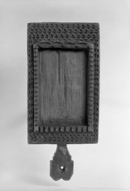 Sioux (Native American). Chief's Looking Glass Frame, early 19th century. Wood, 7 x 3 1/4 in. (17.8 x 8.3 cm). Brooklyn Museum, Henry L. Batterman Fund and the Frank Sherman Benson Fund, 50.67.108. Creative Commons-BY