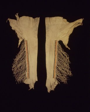 Sioux (Native American). Pair of Leggings, early 19th century. Buckskin, porcupine quills, pony beads, seed beads, pigment, 40 in. (101.6 cm). Brooklyn Museum, Henry L. Batterman Fund and the Frank Sherman Benson Fund, 50.67.10a-b. Creative Commons-BY