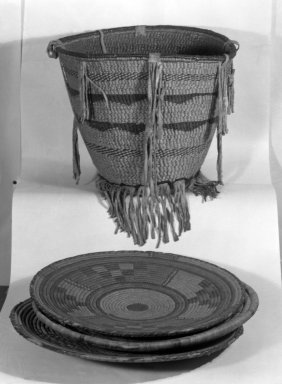 Native American (unidentified). Burden Carrier's Basket, 1868-1900. Rush, hide, cotton, 14 1/4 x 16 x 16 in. (36.2 x 40.6 x 40.6 cm). Brooklyn Museum, Henry L. Batterman Fund and the Frank Sherman Benson Fund, 50.67.128. Creative Commons-BY