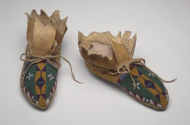 Native American, possibly Sarsi. Pair of Moccasins, 19th century. Hide, glass beads, 4 x 3 3/4 x 9 1/2 in. (10.2 x 9.5 x 24.1 cm). Brooklyn Museum, Henry L. Batterman Fund and Frank Sherman Benson Fund, 50.67.19a-b. Creative Commons-BY