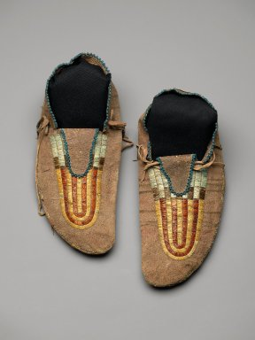 Sioux (Native American). Pair of Moccasins, early 19th century. Hide, beads, bird quills, porcupine quills, tin, deer hair, sinew, pigment, 4 x 5 x 11 in. (10.2 x 12.7 x 27.9 cm). Brooklyn Museum, Henry L. Batterman Fund and Frank Sherman Benson Fund, 50.67.23a-b. Creative Commons-BY