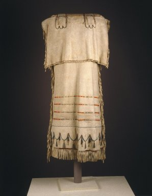 Probably Yanktonai, Nakota, Sioux (Native American). Strap Dress with Red and Green Embroidery, early 19th century. Emulsion cured buckskin, dyed porcupine quills, glass beads, tin and copper tinklers, thread, sinew and pigment, 46 x 21 in.  (116.8 x 53.3 cm). Brooklyn Museum, Henry L. Batterman Fund and Frank Sherman Benson Fund, 50.67.2. Creative Commons-BY