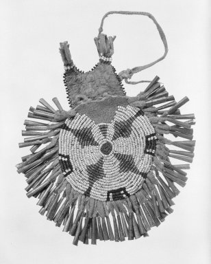 Plains (Native American). Circular Beaded Pouch with Jingles, 19th century. Hide, beads, metal, cotton thread, 4 3/4 x 5 in. (12.1 x 12.7 cm). Brooklyn Museum, Henry L. Batterman Fund and the Frank Sherman Benson Fund, 50.67.35. Creative Commons-BY