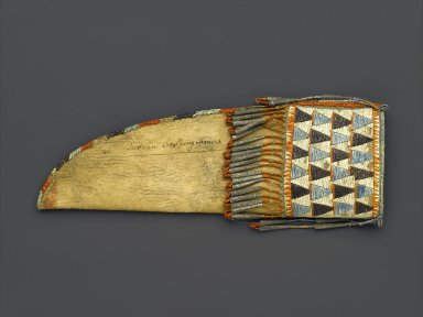 Eastern, Sioux (Native American). Knife Sheath, early 19th century. Rawhide, buckskin, porcupine quills, tin, sinew, thread, 9 1/2 x 3 1/4 in. (24.1 x 8.3 cm). Brooklyn Museum, Henry L. Batterman Fund and the Frank Sherman Benson Fund, 50.67.41. Creative Commons-BY