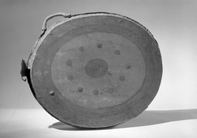 Great Lakes (Native American). Double-headed Drum, early 19th century. Hide, wood, pigment, 19 7/8 x 2 1/2 x 16 1/8 in. (50.5 x 6.4 x 41 cm). Brooklyn Museum, Henry L. Batterman Fund and the Frank Sherman Benson Fund, 50.67.81. Creative Commons-BY