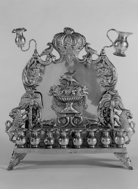 B. Szkarlad. Hanukkah Lamp, ca. 1900. Silver, 10 3/4 x 10 1/8 x 3 1/4 in. (27.3 x 25.7 x 8.3 cm). Brooklyn Museum, Gift of Mrs. William Linder in memory of Dr. William Linder, 50.7. Creative Commons-BY