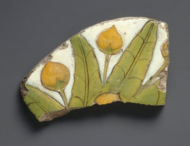 Tile Fragment with Mandragora Fruit and Leaves, 1352-1336 B.C.E. Faience, 2 15/16 x 5 5/16 in.  (7.5 x 13.5 cm). Brooklyn Museum, Charles Edwin Wilbour Fund, 52.148.2. Creative Commons-BY