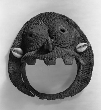 Ovoid Mask, late 19th century. Woven basketry, 5 11/16 x 5 5/16 in. (14.5 x 13.5 cm). Brooklyn Museum, Gift of Julius Carlebach, 53.150.1. Creative Commons-BY