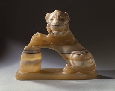 Lion Holding Vessel, 525-404 B.C.E. Banded Egyptian alabaster, 4 x 4 3/4 x 2 in. (10.2 x 12.1 x 5.1 cm). Brooklyn Museum, Charles Edwin Wilbour Fund, 53.223. Creative Commons-BY