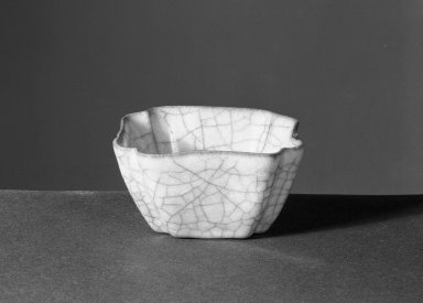 Square Flower-Shaped Washer, 1271-1368. High-fired green ware (celadon), 1 9/16 x 2 3/4 in. (4 x 7 cm). Brooklyn Museum, Gift of Samuel P. Avery, by exchange, 53.51. Creative Commons-BY