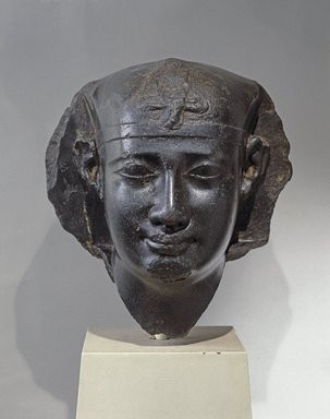 Head of a King, 3rd century B.C.E. (probably). Basalt, 16 x 16 1/2 x 16 in. (40.6 x 41.9 x 40.6 cm). Brooklyn Museum, Charles Edwin Wilbour Fund, 53.75. Creative Commons-BY